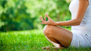 Woman-in-a-cross-legged-meditation-pose